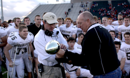 Coach Cody White accepts UIL trophy