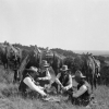 Edwin Sanders (right) and Three Cowboys Taking Time out for a Game of Hearts, Three Circles Ranch, Texas 1906, Nitrate negative, 4 x 5 inches.
